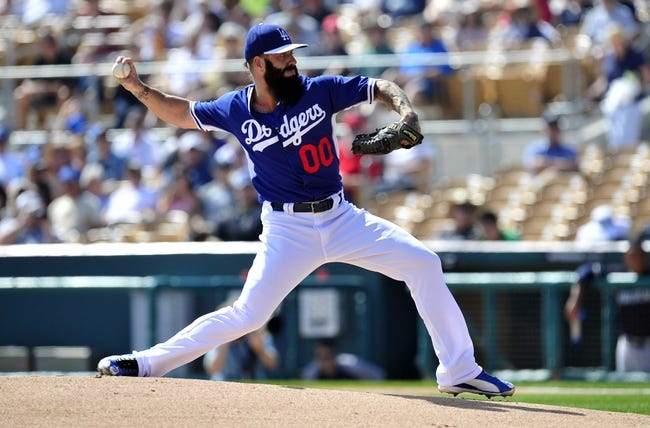March 4, 2014; Phoenix, AZ, USA; Los Angeles Dodgers pitcher Brian Wilson (00) pitches during the first inning against the Seattle Mariners at Camelback Ranch. Mandatory Credit: Gary A. Vasquez-USA TODAY Sports