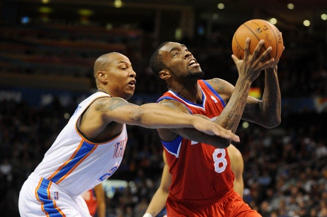 Mar 4, 2014; Oklahoma City, OK, USA; Philadelphia 76ers shooting guard Tony Wroten (8) attempts a shot against Oklahoma City Thunder small forward Caron Butler (2) during the second quarter at Chesapeake Energy Arena. Mandatory Credit: Mark D. Smith-USA TODAY Sports