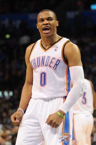 Mar 4, 2014; Oklahoma City, OK, USA; Oklahoma City Thunder point guard Russell Westbrook (0) reacts after a play against the Philadelphia 76ers at Chesapeake Energy Arena. Mandatory Credit: Mark D. Smith-USA TODAY Sports