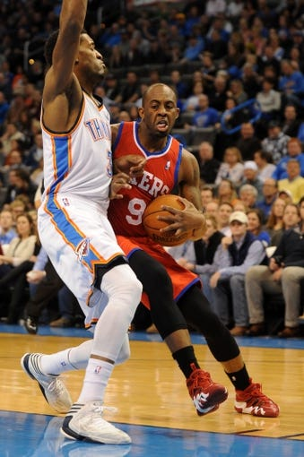 Mar 4, 2014; Oklahoma City, OK, USA; Philadelphia 76ers shooting guard James Anderson (9) handles the ball against Oklahoma City Thunder small forward Perry Jones (3) during the first quarter at Chesapeake Energy Arena. Mandatory Credit: Mark D. Smith-USA TODAY Sports