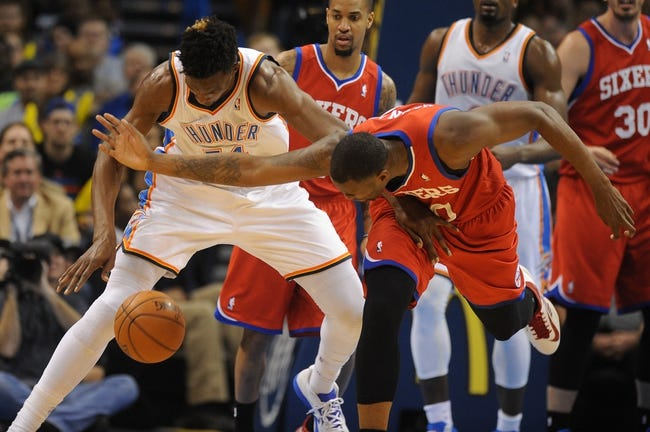 Mar 4, 2014; Oklahoma City, OK, USA; Philadelphia 76ers power forward Jarvis Varnado (40) fights for a loose ball against Oklahoma City Thunder center Hasheem Thabeet (34) during the fourth quarter at Chesapeake Energy Arena. Mandatory Credit: Mark D. Smith-USA TODAY Sports