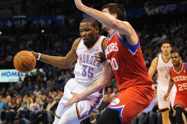 Mar 4, 2014; Oklahoma City, OK, USA; Oklahoma City Thunder small forward Kevin Durant (35) handles the ball against Philadelphia 76ers center Byron Mullens (30) during the third quarter at Chesapeake Energy Arena. Mandatory Credit: Mark D. Smith-USA TODAY Sports