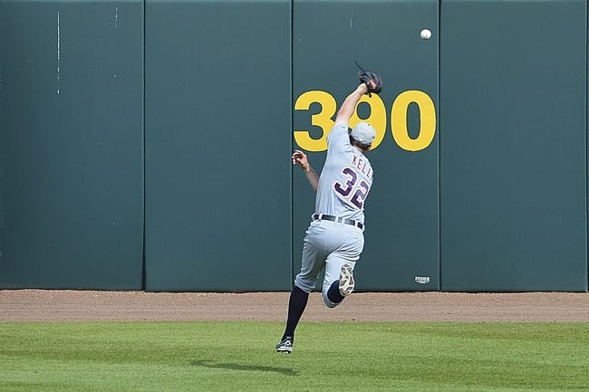 Mar 5, 2014; Kissimmee, FL, USA;  A pop fly sails over the head of Detroit Tigers left fielder Don Kelly (32) during the fifth inning against the Houston Astros at Osceola County Stadium. Mandatory Credit: Tommy Gilligan-USA TODAY Sports