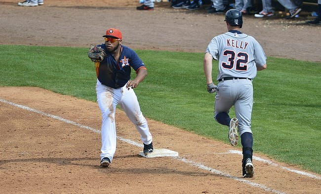 Mar 5, 2014; Kissimmee, FL, USA;  Houston Astros first baseman Jon Singleton (13) forces out Detroit Tigers left fielder Don Kelly (32) during the fifth inning at Osceola County Stadium. Mandatory Credit: Tommy Gilligan-USA TODAY Sports