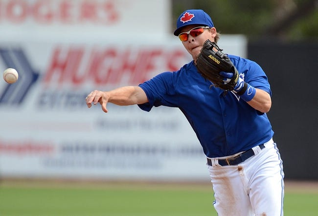 Mar 5, 2014; Dunedin, FL, USA; Toronto Blue Jays infielder Chris Getz (39) throws the ball during the spring training exhibition game against the Pittsburg Pirates at Florida Auto Exchange Park. Mandatory Credit: Jonathan Dyer-USA TODAY Sports