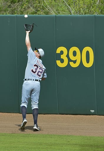 Mar 5, 2014; Kissimmee, FL, USA;  Detroit Tigers left fielder Don Kelly (32) catches a fly ball during the fourth inning against the Houston Astros at Osceola County Stadium. Mandatory Credit: Tommy Gilligan-USA TODAY Sports