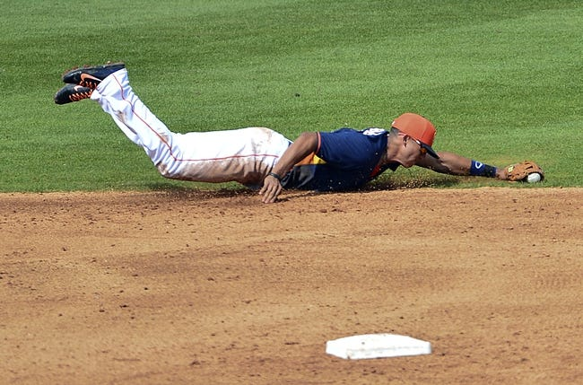 Mar 5, 2014; Kissimmee, FL, USA;  Houston Astros shortstop Carlos Correa (84) dives for a ground ball during the fourth inning against the Detroit Tigers at Osceola County Stadium. Mandatory Credit: Tommy Gilligan-USA TODAY Sports