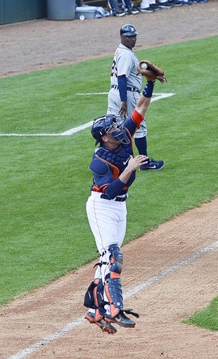 Mar 5, 2014; Kissimmee, FL, USA;  Houston Astros catcher Jason Castro (15) leaps to make a catch during the fourth inning against the Detroit Tigers at Osceola County Stadium. Mandatory Credit: Tommy Gilligan-USA TODAY Sports