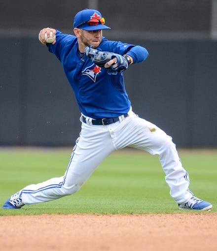 Mar 5, 2014; Dunedin, FL, USA; Toronto Blue Jays shortstop Jonathan Diaz (1) throws the ball during the spring training exhibition game against the Pittsburg Pirates at Florida Auto Exchange Park. Mandatory Credit: Jonathan Dyer-USA TODAY Sports