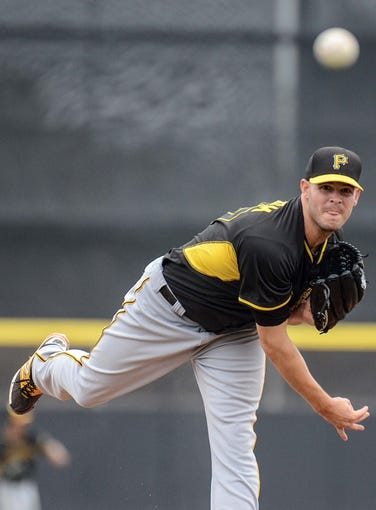 Mar 5, 2014; Dunedin, FL, USA; Pittsburg Pirates pitcher Jake Brigham (67) warms up during the spring training exhibition game against the Toronto Blue Jays at Florida Auto Exchange Park. Mandatory Credit: Jonathan Dyer-USA TODAY Sports