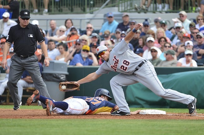 Mar 5, 2014; Kissimmee, FL, USA;  Houston Astros second baseman Jose Altuve (27) slides safely back to first under the tag of Detroit Tigers first baseman Jordan Lennerton (28) during the first inning at Osceola County Stadium. Mandatory Credit: Tommy Gilligan-USA TODAY Sports