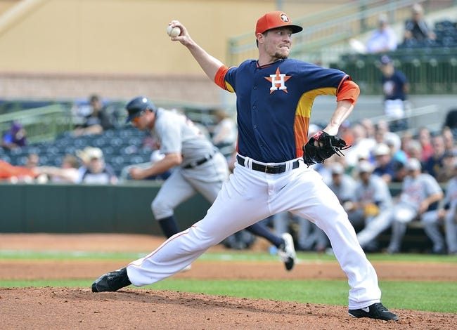 Mar 5, 2014; Kissimmee, FL, USA;  Houston Astros starting pitcher Lucas Harrell (64) pitches during the second inning against the Detroit Tigers at Osceola County Stadium. Mandatory Credit: Tommy Gilligan-USA TODAY Sports