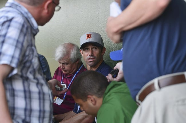 Mar 5, 2014; Kissimmee, FL, USA;  Detroit Tigers manager Brad Ausmus (7) speaks with the media in the dugout before the game against the Houston Astros at Osceola County Stadium. Mandatory Credit: Tommy Gilligan-USA TODAY Sports