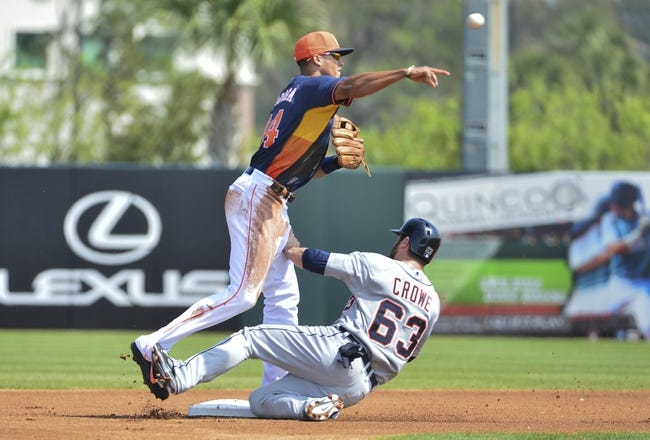 Mar 5, 2014; Kissimmee, FL, USA;  Detroit Tigers left fielder Trevor Crowe (63) breaks up a double play attempt by Houston Astros shortstop Carlos Correa (84) in the first inning at Osceola County Stadium. Mandatory Credit: Tommy Gilligan-USA TODAY Sports