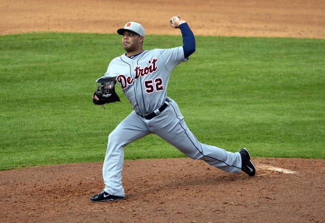 Mar 5, 2014; Kissimmee, FL, USA;  Detroit Tigers starting pitcher Jose Alvarez (52) pitches during the fourth inning against the  Houston Astros at Osceola County Stadium. Mandatory Credit: Tommy Gilligan-USA TODAY Sports