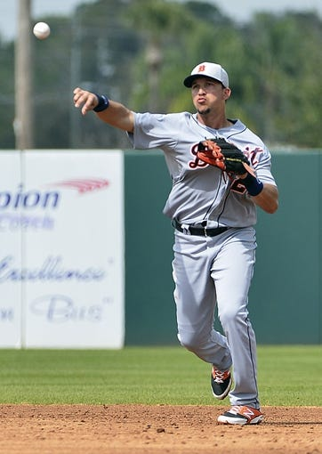 Mar 5, 2014; Kissimmee, FL, USA;  Detroit Tigers second baseman Hernan Perez (26) throws to first base during the fourth inning against the Houston Astros at Osceola County Stadium. Mandatory Credit: Tommy Gilligan-USA TODAY Sports