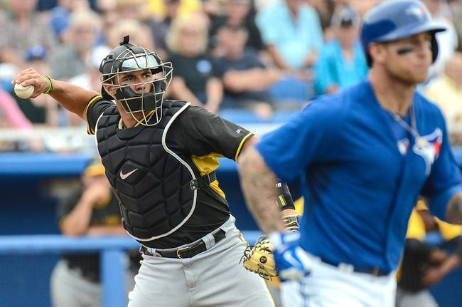 Mar 5, 2014; Dunedin, FL, USA; Pittsburg Pirates catcher Tony Sanchez (26) throws to first base during the spring training exhibition game against the Toronto Blue Jays  at Florida Auto Exchange Park. Mandatory Credit: Jonathan Dyer-USA TODAY Sports