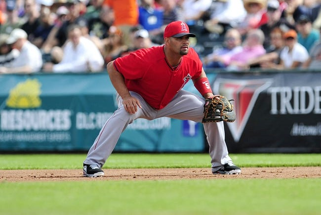 March 5, 2014; Scottsdale, AZ, USA; Los Angeles Angels first baseman Albert Pujols (5) in defensive position during the first inning against the San Francisco Giants  at Scottsdale Stadium. Mandatory Credit: Gary A. Vasquez-USA TODAY Sports