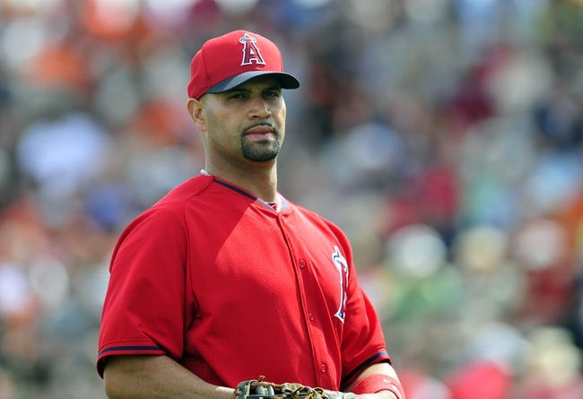 March 5, 2014; Scottsdale, AZ, USA; Los Angeles Angels first baseman Albert Pujols (5) on field against the San Francisco Giants  at Scottsdale Stadium. Mandatory Credit: Gary A. Vasquez-USA TODAY Sports
