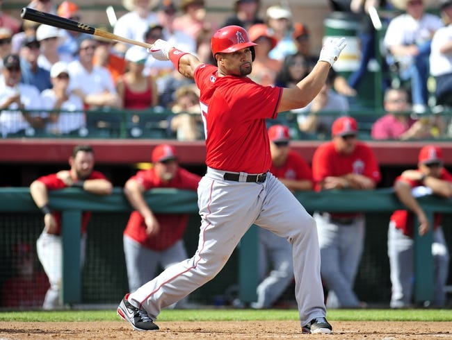 March 5, 2014; Scottsdale, AZ, USA; Los Angeles Angels first baseman Albert Pujols (5) at bat during the fourth inning against the San Francisco Giants  at Scottsdale Stadium. Mandatory Credit: Gary A. Vasquez-USA TODAY Sports