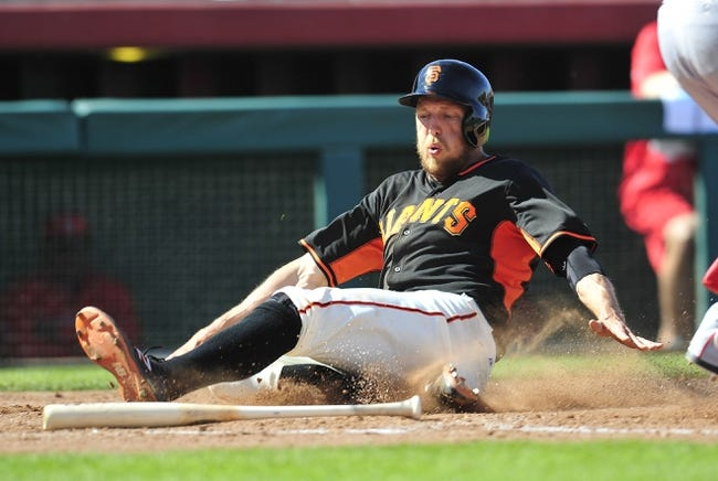March 5, 2014; Scottsdale, AZ, USA; San Francisco Giants right fielder Hunter Pence (8) scores a run in the fifth inning against the Los Angeles Angels at Scottsdale Stadium. Mandatory Credit: Gary A. Vasquez-USA TODAY Sports