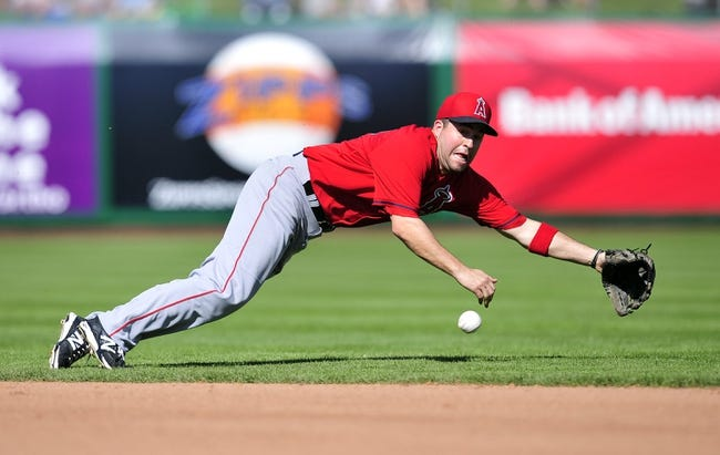March 5, 2014; Scottsdale, AZ, USA; Los Angeles Angels shortstop John McDonald (18) fields a hit in the fifth inning against the San Francisco Giants  at Scottsdale Stadium. Mandatory Credit: Gary A. Vasquez-USA TODAY Sports
