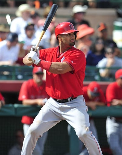 March 5, 2014; Scottsdale, AZ, USA; Los Angeles Angels first baseman Albert Pujols (5) at bat against the San Francisco Giants  at Scottsdale Stadium. Mandatory Credit: Gary A. Vasquez-USA TODAY Sports