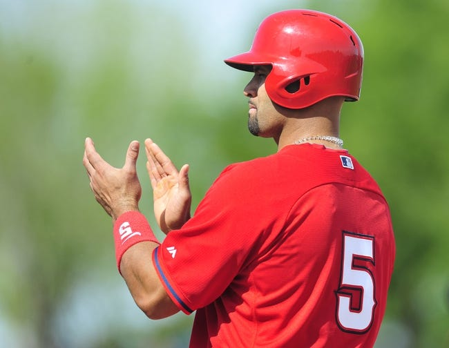 March 5, 2014; Scottsdale, AZ, USA; Los Angeles Angels first baseman Albert Pujols (5) reacts against the San Francisco Giants  at Scottsdale Stadium. Mandatory Credit: Gary A. Vasquez-USA TODAY Sports