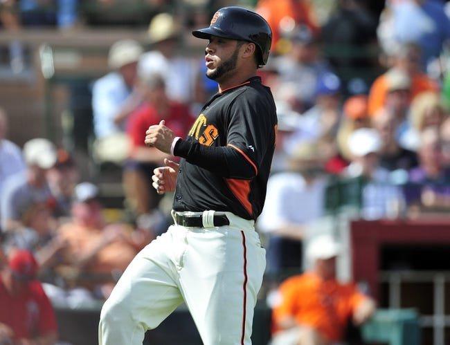 March 5, 2014; Scottsdale, AZ, USA; San Francisco Giants center fielder Gregor Blanco (7) scores a run in the first inning against the Los Angeles Angels at Scottsdale Stadium. Mandatory Credit: Gary A. Vasquez-USA TODAY Sports
