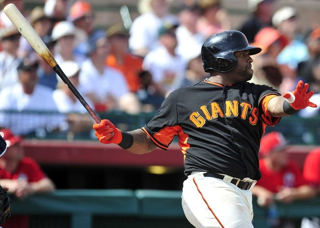 March 5, 2014; Scottsdale, AZ, USA; San Francisco Giants third baseman Pablo Sandoval (48) hits an RBI single in the third inning against the Los Angeles Angels at Scottsdale Stadium. Mandatory Credit: Gary A. Vasquez-USA TODAY Sports
