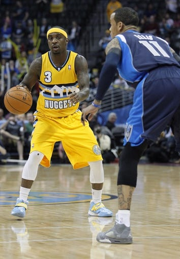 Mar 5, 2014; Denver, CO, USA; Dallas Mavericks shooting guard Monta Ellis (11) guards Denver Nuggets point guard Ty Lawson (3) in the first quarter at the Pepsi Center. Mandatory Credit: Isaiah J. Downing-USA TODAY Sports