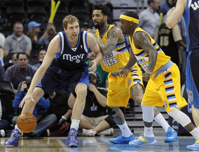 Mar 5, 2014; Denver, CO, USA; Denver Nuggets point guard Ty Lawson (3) watches as shooting guard Wilson Chandler (21) guards Dallas Mavericks power forward Dirk Nowitzki (41) in the first quarter at the Pepsi Center. Mandatory Credit: Isaiah J. Downing-USA TODAY Sports