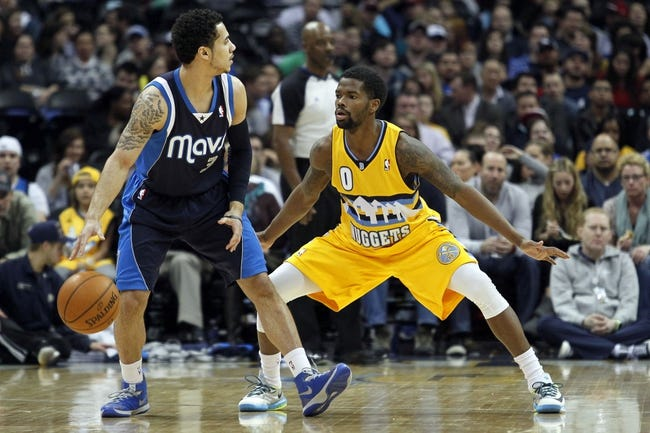 Mar 5, 2014; Denver, CO, USA; Denver Nuggets point guard Aaron Brooks (0) defends against Dallas Mavericks point guard Shane Larkin (3) in the second quarter at the Pepsi Center. Mandatory Credit: Isaiah J. Downing-USA TODAY Sports