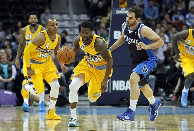 Mar 5, 2014; Denver, CO, USA; Denver Nuggets point guard Aaron Brooks (0) picks up a loose ball against Dallas Mavericks point guard Jose Calderon (8) in the second quarter at the Pepsi Center. Mandatory Credit: Isaiah J. Downing-USA TODAY Sports