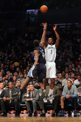 Mar 5, 2014; Brooklyn, NY, USA; Brooklyn Nets shooting guard Joe Johnson (7) shoots a three-point shot over Memphis Grizzlies shooting guard Tony Allen (9) during the third quarter of a game at Barclays Center. The Nets defeated the Grizzlies 103-94. Mandatory Credit: Brad Penner-USA TODAY Sports