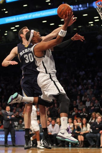 Mar 5, 2014; Brooklyn, NY, USA; Brooklyn Nets small forward Paul Pierce (34) drives past Memphis Grizzlies power forward Jon Leuer (30) during the third quarter of a game at Barclays Center. The Nets defeated the Grizzlies 103-94. Mandatory Credit: Brad Penner-USA TODAY Sports