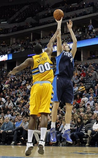 Mar 5, 2014; Denver, CO, USA; Dallas Mavericks power forward Dirk Nowitzki (41) takes a shot against Denver Nuggets power forward Darrell Arthur (00) in the fourth quarter at the Pepsi Center. The Nuggets won 115-110. Mandatory Credit: Isaiah J. Downing-USA TODAY Sports