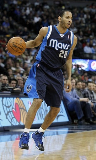 Mar 5, 2014; Denver, CO, USA; Dallas Mavericks point guard Devin Harris (20) controls the ball in the third quarter against the Denver Nuggets at the Pepsi Center. The Nuggets won 115-110. Mandatory Credit: Isaiah J. Downing-USA TODAY Sports
