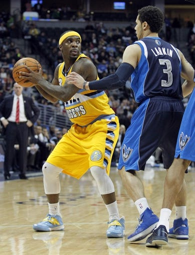 Mar 5, 2014; Denver, CO, USA; Dallas Mavericks point guard Shane Larkin (3) guards Denver Nuggets point guard Ty Lawson (3) in the second quarter at the Pepsi Center. Mandatory Credit: Isaiah J. Downing-USA TODAY Sports