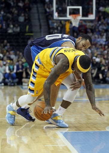 Mar 5, 2014; Denver, CO, USA; Dallas Mavericks point guard Devin Harris (20) and Denver Nuggets point guard Ty Lawson (3) battle for the ball in the first quarter at the Pepsi Center. Mandatory Credit: Isaiah J. Downing-USA TODAY Sports