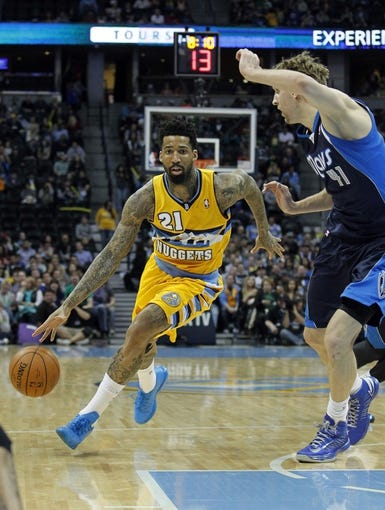 Mar 5, 2014; Denver, CO, USA; Denver Nuggets shooting guard Wilson Chandler (21) drives to the net against Dallas Mavericks power forward Dirk Nowitzki (41) in the second quarter at the Pepsi Center. Mandatory Credit: Isaiah J. Downing-USA TODAY Sports