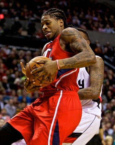 Mar 5, 2014; Portland, OR, USA; Atlanta Hawks small forward Cartier Martin (20) collects a rebound against the Portland Trail Blazers during the second quarter at the Moda Center. Mandatory Credit: Craig Mitchelldyer-USA TODAY Sports