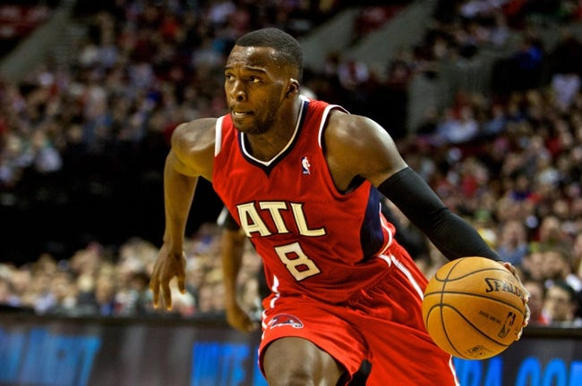 Mar 5, 2014; Portland, OR, USA; Atlanta Hawks point guard Shelvin Mack (8) drives to the basket against the Portland Trail Blazers during the second quarter at the Moda Center. Mandatory Credit: Craig Mitchelldyer-USA TODAY Sports