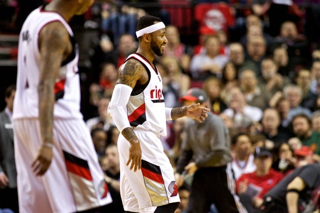 Mar 5, 2014; Portland, OR, USA; Portland Trail Blazers point guard Mo Williams (25) smiles after scoring during the second quarter against the Atlanta Hawks at the Moda Center. Mandatory Credit: Craig Mitchelldyer-USA TODAY Sports