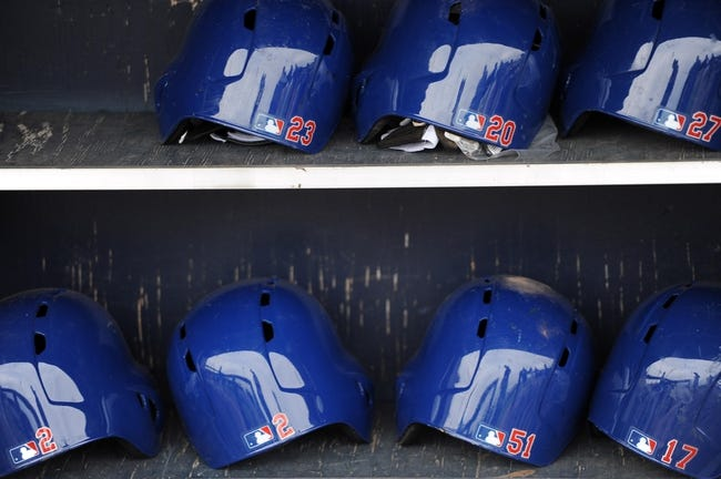 Mar 6, 2014; Peoria, AZ, USA; Texas Rangers helmets sit in the dugout area against the San Diego Padres at Peoria Sports Complex. The Rangers won 8-4. Mandatory Credit: Joe Camporeale-USA TODAY Sports