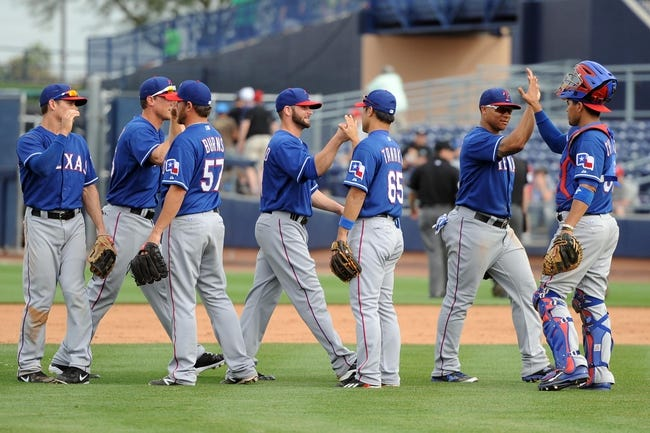Mar 6, 2014; Peoria, AZ, USA; The Texas Rangers celebrate after defeating the San Diego Padres at Peoria Sports Complex. The Rangers won 8-4. Mandatory Credit: Joe Camporeale-USA TODAY Sports