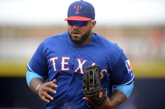 Mar 6, 2014; Peoria, AZ, USA; Texas Rangers first baseman Prince Fielder (84) runs to first base for a put out after fielding a ground ball against the San Diego Padres at Peoria Sports Complex. The Rangers won 8-4. Mandatory Credit: Joe Camporeale-USA TODAY Sports