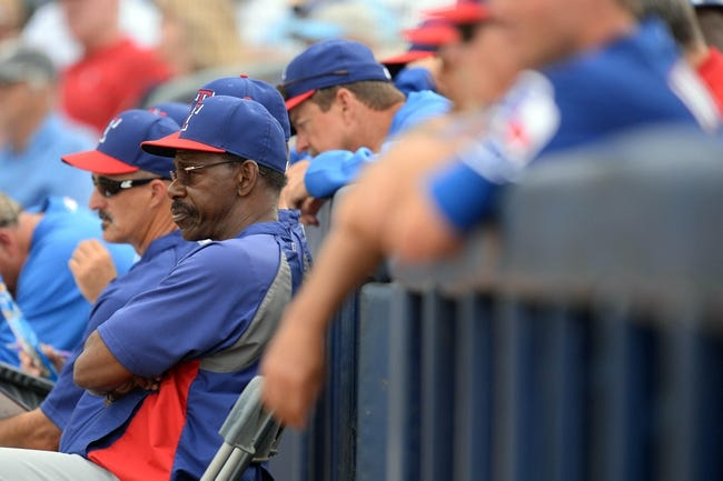 Mar 6, 2014; Peoria, AZ, USA; Texas Rangers manager Ron Washington looks on against the San Diego Padres in the ninth inning at Peoria Sports Complex. The Rangers won 8-4. Mandatory Credit: Joe Camporeale-USA TODAY Sports