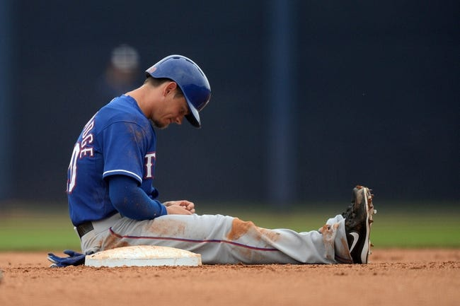 Mar 6, 2014; Peoria, AZ, USA; Texas Rangers shortstop Brent Lillibridge (20) sits at second base after being forced out against the San Diego Padres in the eighth inning at Peoria Sports Complex. The Rangers won 8-4. Mandatory Credit: Joe Camporeale-USA TODAY Sports