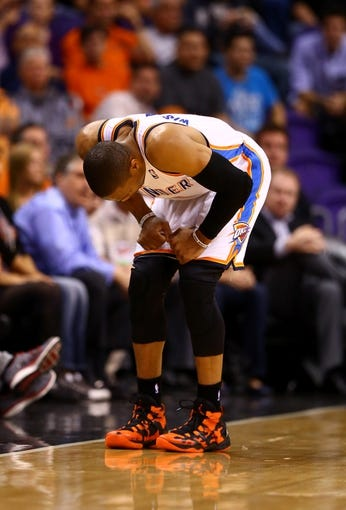 Mar 6, 2014; Phoenix, AZ, USA; Oklahoma City Thunder guard Russell Westbrook reacts after suffering an injury in the second quarter against the Phoenix Suns at the US Airways Center. Mandatory Credit: Mark J. Rebilas-USA TODAY Sports